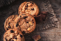 Chocolate chip cookies on dark old wooden table with place for t Royalty Free Stock Photo