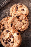 Chocolate chip cookies on dark old wooden table with place for t Stock Photos