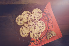 Chocolate Chip Cookies on Dark Wood Background. Stock Photos