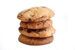 Chocolate chip cookies four stacked. Home baked chocolate chip cookies.  Four staked on top of each other on white background Stock Images