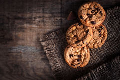 Chocolate chip cookies,  freshly baked on rustic wooden table. S Royalty Free Stock Images