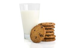 Chocolate chip cookies and a glass of milk Stock Images