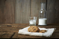 Chocolate chip cookies with glass of milk, on withe cheesecloth Stock Photo