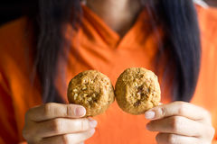 Chocolate chip cookies in hands woman Royalty Free Stock Photography
