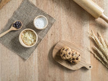 Chocolate chip cookies and ingredient on wooden table Royalty Free Stock Photography