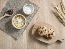 Chocolate chip cookies and ingredient on wooden table Stock Photography