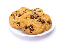 Chocolate chip cookies isolated on white. Chocolate chip cookies on a white plate isolated on white Stock Photo