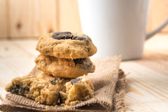 Chocolate chip cookies on linen napkin on wooden table. Stacked royalty free stock photo