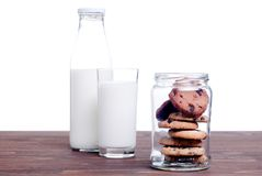 Chocolate chip cookies with milk on the board side view Royalty Free Stock Photo