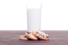 Chocolate chip cookies with milk on the board side view Stock Photo