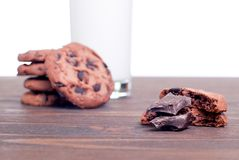 Chocolate chip cookies with milk on the board side view Stock Image