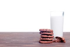 Chocolate chip cookies with milk on the board side view Stock Photography