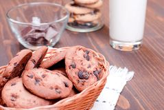Chocolate chip cookies with milk on the board top view Royalty Free Stock Images