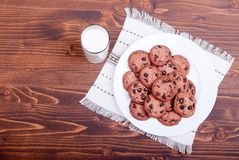 Chocolate chip cookies with milk on the board top view Royalty Free Stock Image