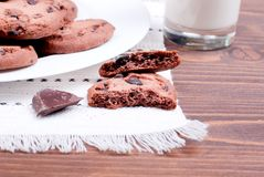Chocolate chip cookies with milk on the board top view Stock Photography