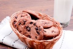 Chocolate chip cookies with milk on the board top view Royalty Free Stock Photos