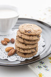 Chocolate chip cookies. With milk in cup on black dish Royalty Free Stock Image