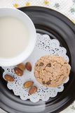 Chocolate chip cookies. With milk in cup on black dish Royalty Free Stock Photography