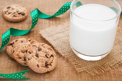 Chocolate chip cookies and milk glass hessian mats Royalty Free Stock Photo