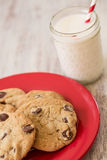 Chocolate Chip Cookies and Milk on Red Plate Stock Photography