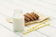 Chocolate chip cookies and milk. Some chocolate chip cookies and a school milk bottle Stock Photo
