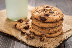 Chocolate chip cookies with milk on wooden table.  Stock Images