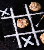 Chocolate chip cookies on noughts and crosses sugar grid Royalty Free Stock Photos