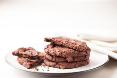 Chocolate Chip Cookies on Plate being Eaten Royalty Free Stock Images