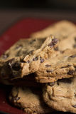 Chocolate Chip Cookies on Plate. Chocolate Chip Cookies on Burgundy Plate stock image
