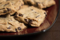 Chocolate Chip Cookies on Plate. Chocolate Chip Cookies on Burgundy Plate stock photo