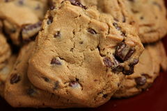Chocolate Chip Cookies on Plate. Chocolate Chip Cookies on Burgundy Plate stock photos