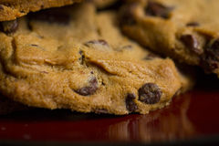 Chocolate Chip Cookies on Plate. Chocolate Chip Cookies on Burgundy Plate royalty free stock photo