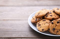 Chocolate chip cookies on plate on grey wooden background stock images
