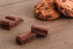 Sweeet life. Cookies and chocolate cubes on table close-up royalty free stock photography