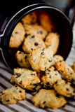 Chocolate chip Cookies. Pouring our from glass jar stock photos