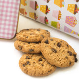 Chocolate chip cookies ready to eat. In the background cookie jar Royalty Free Stock Photography