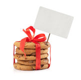 Chocolate chip cookies and red ribbon with price tag Royalty Free Stock Photography