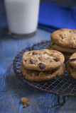 Chocolate Chip Cookies on a rustic cooling rack Royalty Free Stock Image