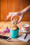 Chocolate chip cookies in small green bucket Stock Photo