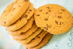 Chocolate chip cookies stacked on blue table set Royalty Free Stock Photography