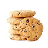 Chocolate chip cookies stacked with one facing out over white Royalty Free Stock Photography