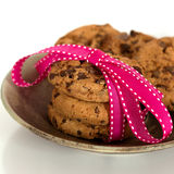 Chocolate chip cookies tied in a ribbon. Celebration and birthday concept. Food background stock photo