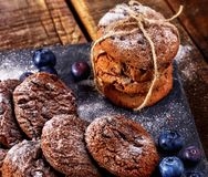Chocolate chip cookies tied with string. Serving food on slate royalty free stock photos