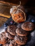 Chocolate chip cookies tied with string. Serving food on slate royalty free stock image
