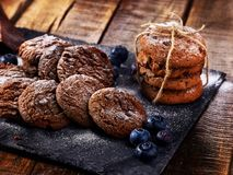 Chocolate chip cookies tied with string. Serving food on slate stock photos