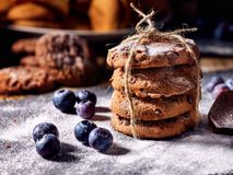 Chocolate chip cookies tied with string on shop window display stock photography