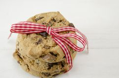 Chocolate chip cookies tied together with a red ribbon Stock Photos