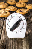 Chocolate Chip Cookies with Timer on Cooling Rack Stock Image