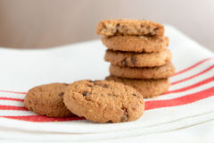 Chocolate chip cookies on white linen napkin on wooden tab stock images