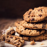 Chocolate chip cookies on wooden background. Stacked chocolate c stock photography